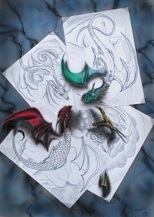 dibujos en hojas de papel que forman unos dragones en 3D