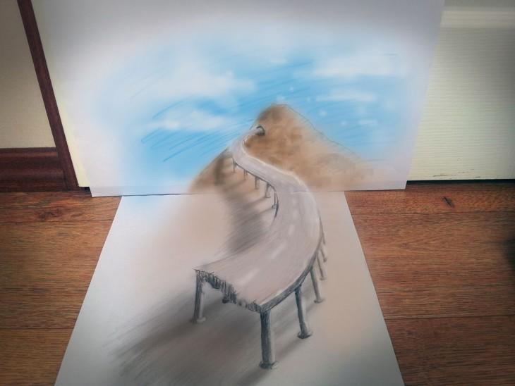 dibujo en 3D sobre una hoja de papel que muestra una carretera