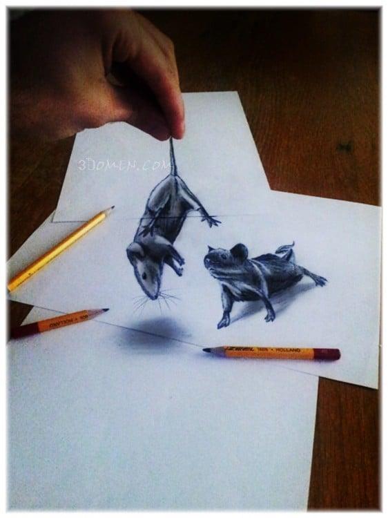 mano simulando que sostiene un dibujo de ratón sobre una hoja de papel
