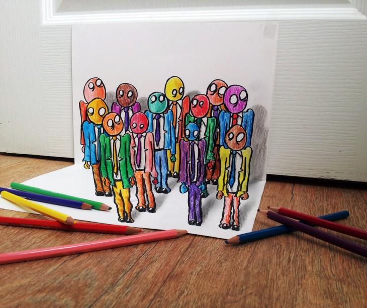 Dibujo en papel de unos monitos de vestir en diferentes colores