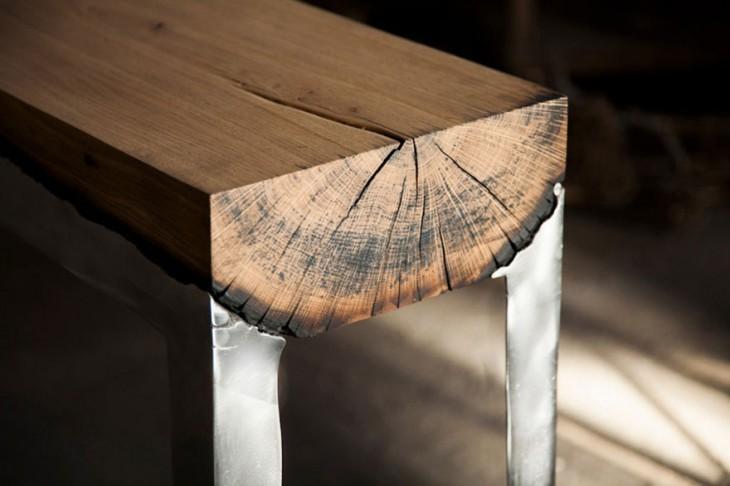 mesa hecha de alumnio y madera fundidos ambos