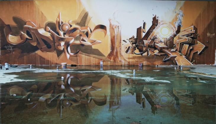 Grafiti sobre un muro que se refleja en el agua