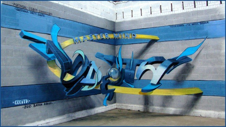 Grafiti 3D de color azul con amarillo sobre una pared