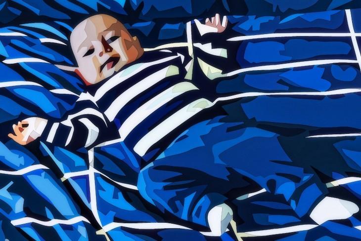 dibujo de un bebe acostado en una cama