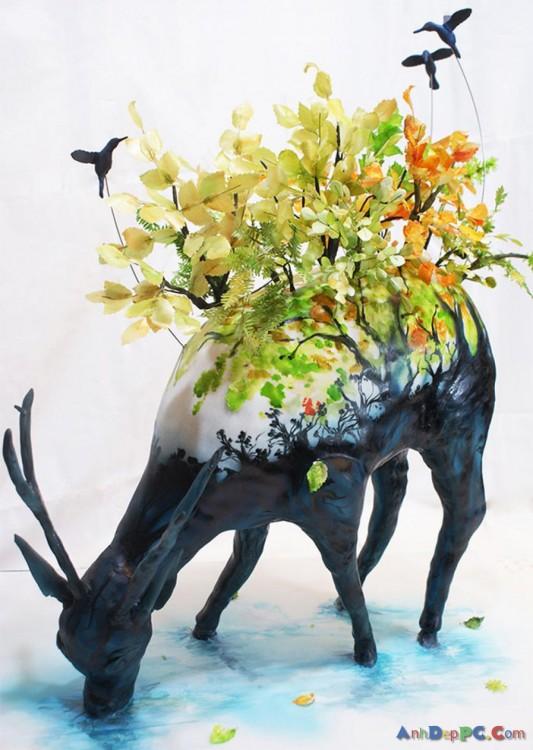 pastel ciervo con jardín en la espalda