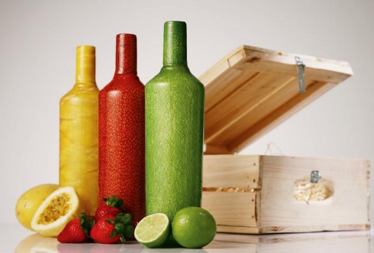 botellas de colores segun el sabor fresa, naranja y limon