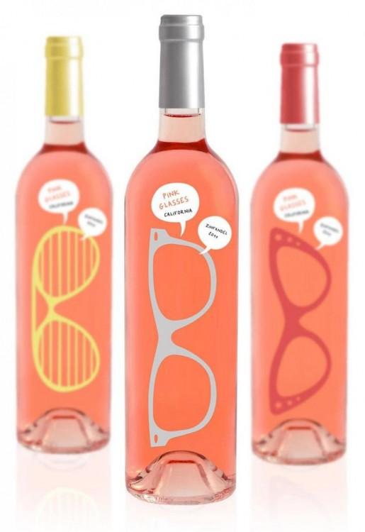 tres botellas rosadas con formas de lentes hipster