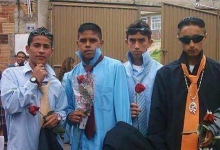 4 hombres cholos con una rosa