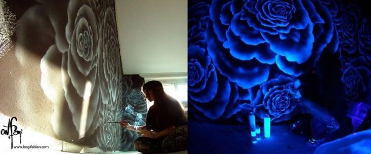 mujer pintando pared neon
