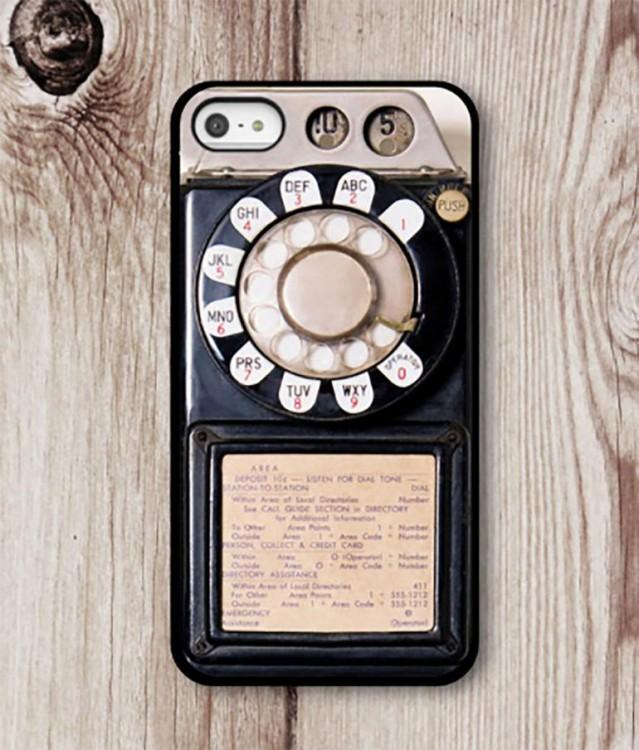 Funda de celular para iphone con un diseño de teléfono antiguo que para marcar se rodaba