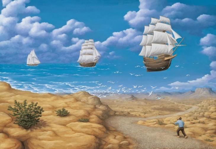 Una persona caminando por un desierto y gaviotas que a lo lejos simulan barcos en un mar