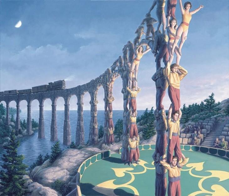 Torre formada con personas que son gimnastas y a lo lejos se convierten en arcos donde pasa un tren