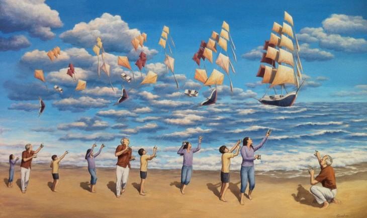 Personas que traen volando un papalote y en el cielo reflejan ser unos barcos sobre el mar