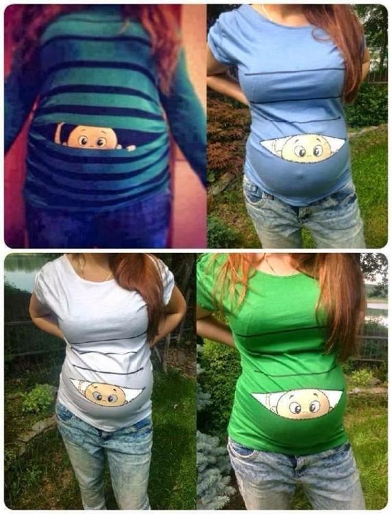 Mujer embarazada luciendo una playera con bebe asomándose en el vientre en diferentes colores