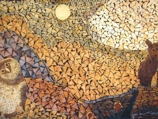 Pedazos de madera que forman figuras y diferentes texturas como un paisaje
