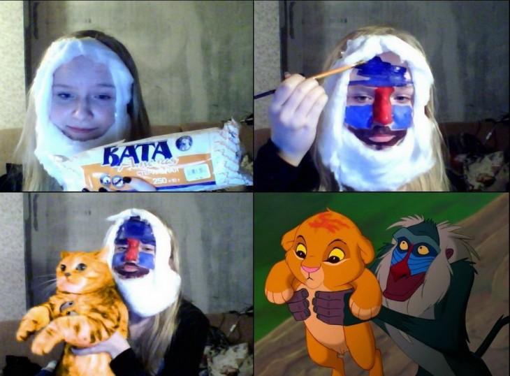 niña con crema batida en la cara sosteniendo un gato
