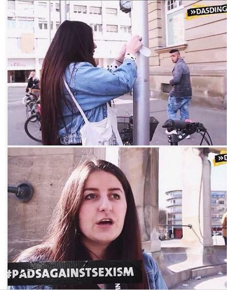 chica pegando cartel en columna