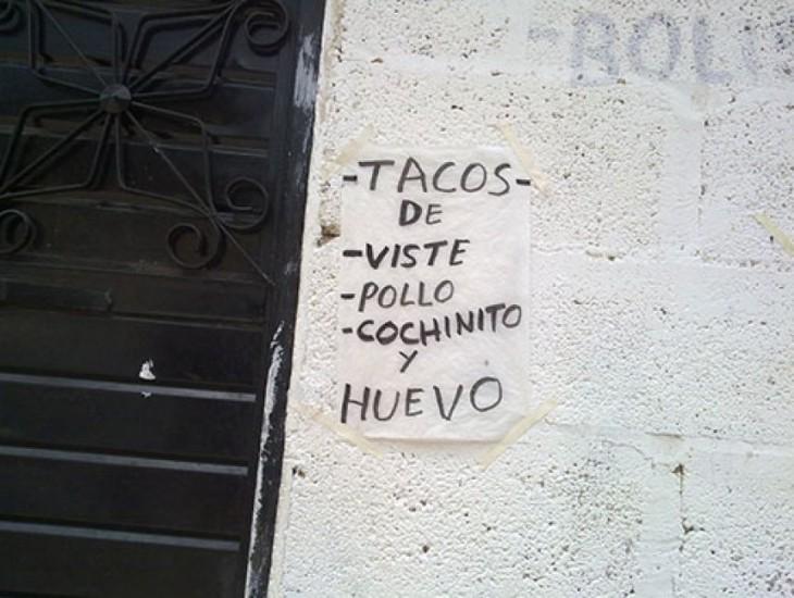 cartel mal escrito de menu de tacos