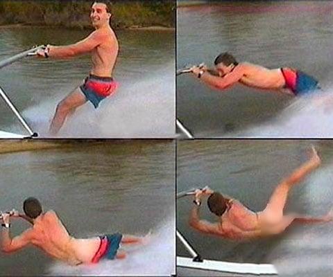 surfista de bote cae al lago sin pantalones