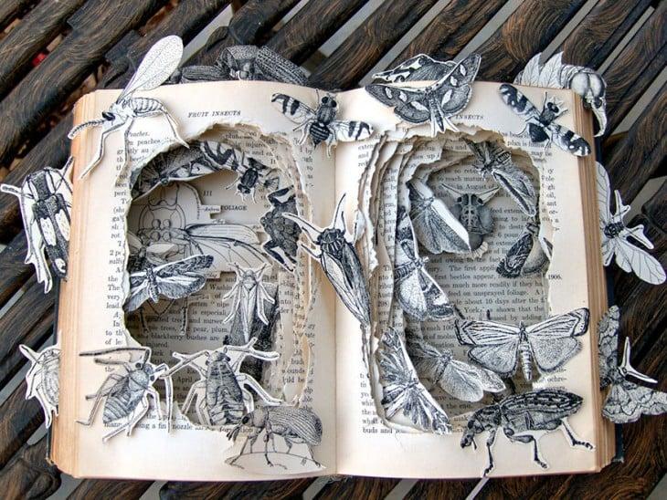 libro hecho arte con insectos que salen de el libro