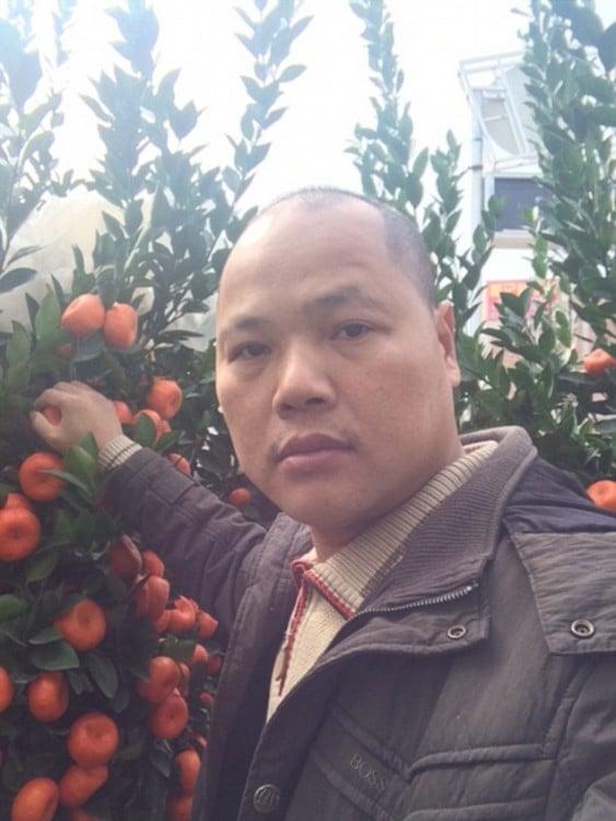 Imagen de un ciudadano chino con un iphone de Matt Stopera