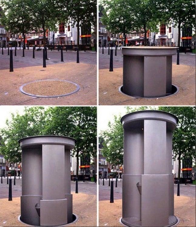 baño que se eleva y hunde en una plaza