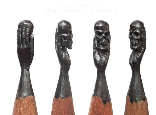 Punta de lápiz con una mano sosteniendo un cráneo