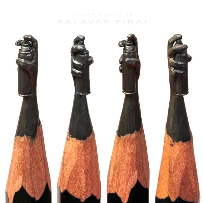Puntas de lápices con una lata de aerosol
