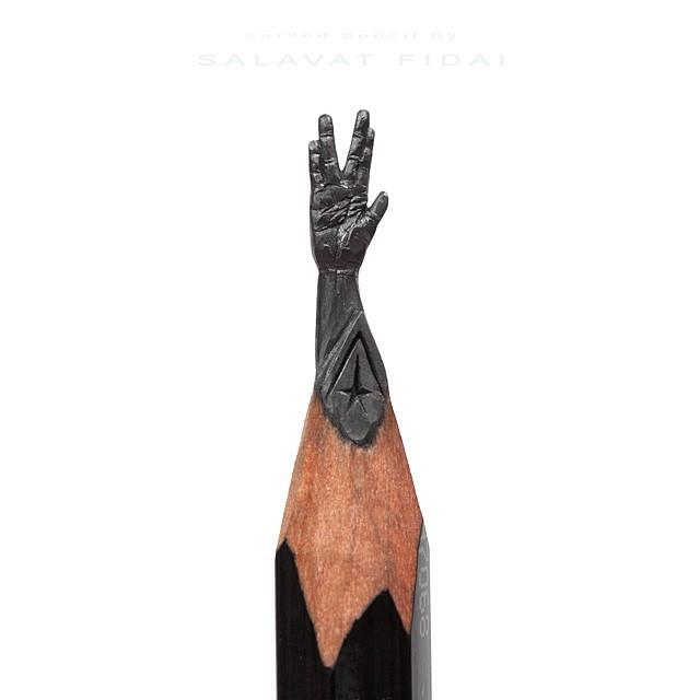 Obra de arte de una mano sobra la punta de un lápiz