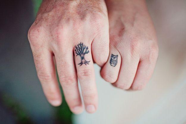 tatuaje de arbol y buho para parejas