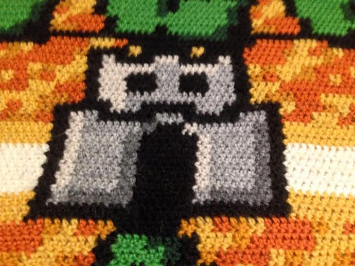 Torre del plano de Mario Bross 3 en una alfombra tejida