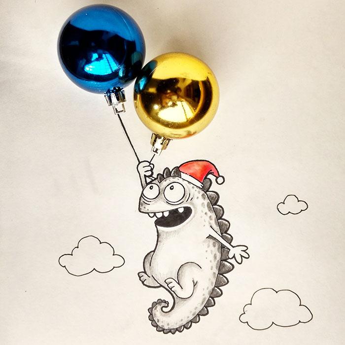 Dibujo del dragón Drogo interactuando con dos esferas de navidad