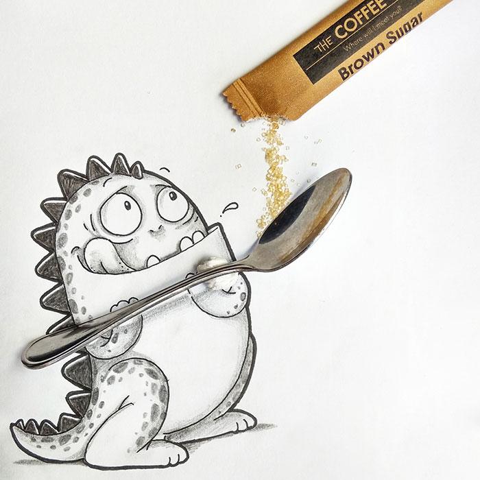 Dibujo de Drogo el dragón interactuando con una cuchara y un sobre de azúcar
