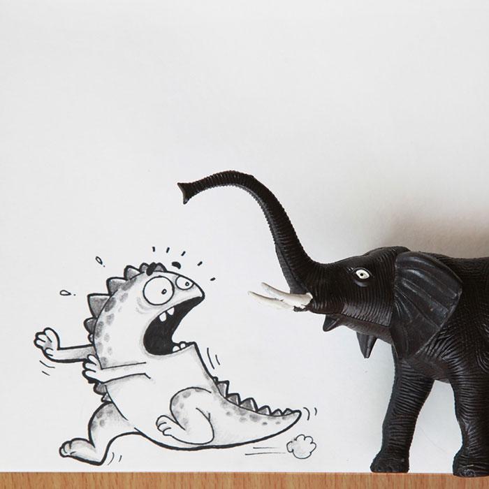 dibujo de dragón drogo interactuando con un juguete en forma de elefante