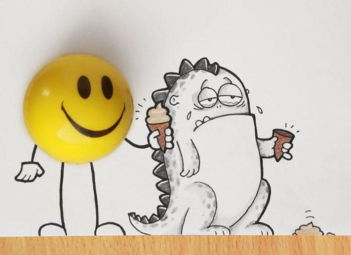 Dibujo del dragón Drogo interactuando con una pelota amarilla