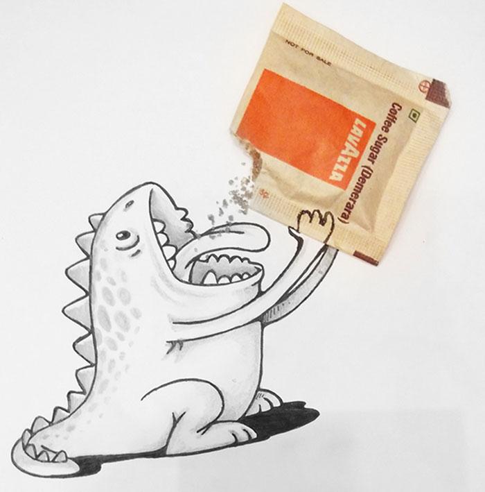 Dragón Drogo interactuando con un sobre de azúcar como si estuviera comiendo