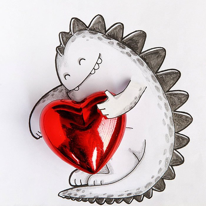 Drogo el dragón interactuando con un corazón rojo