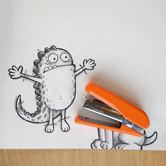 Dibujo de Drogo el dragón interactuando con una grapadora