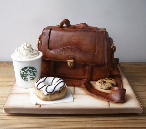 Pastel creativo en fomra de maletin con un starbucks donas y galletas