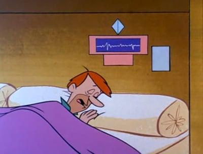 Sonico acostado y será despertado con su despertador que habla