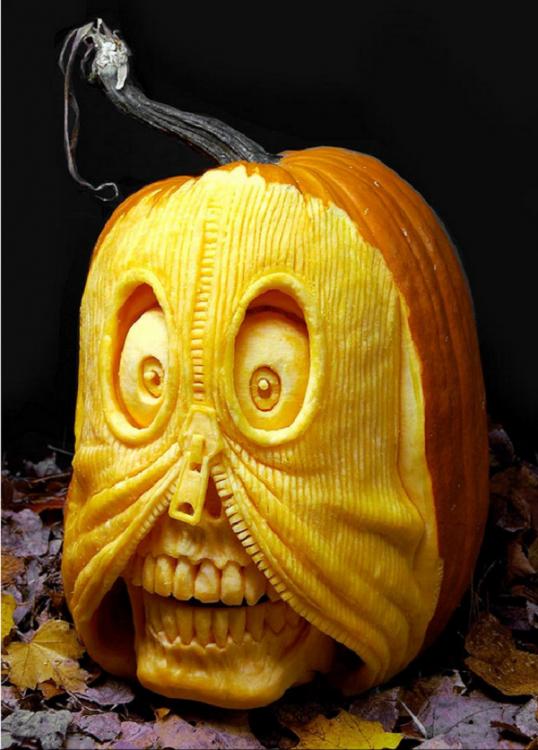arte con calabazas en forma de cráneo que se esta abriendo con un cierre