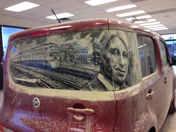dibujo de un hombre con un tren detrás en una camioneta roja sucia