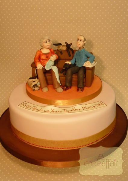 pastel con la figura de un sofá con dos personas rodeados de gatos