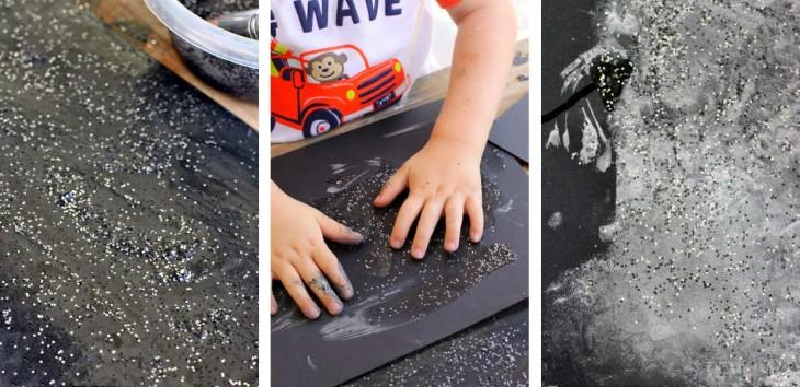 Resultado de una pintura de polvo lunar en una cartulina de color negro