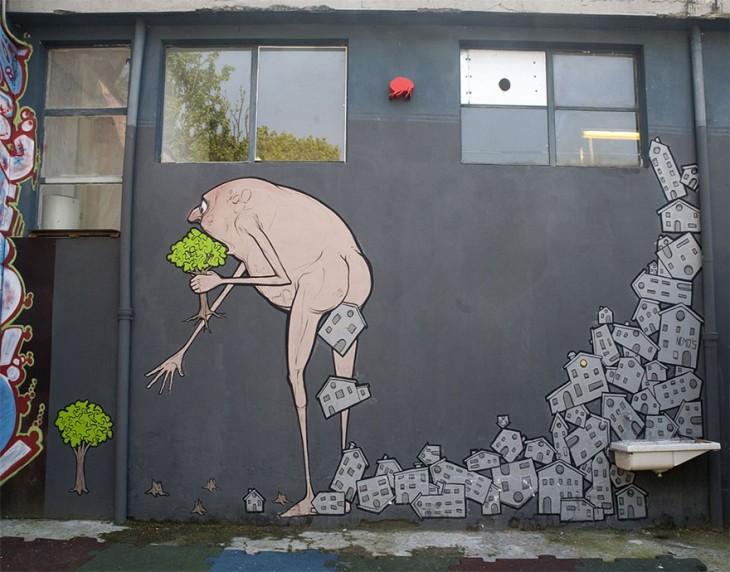 Dibujo en la pared de una persona que se come las plantas y hace casas