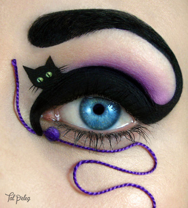 gato jugando con hilo
