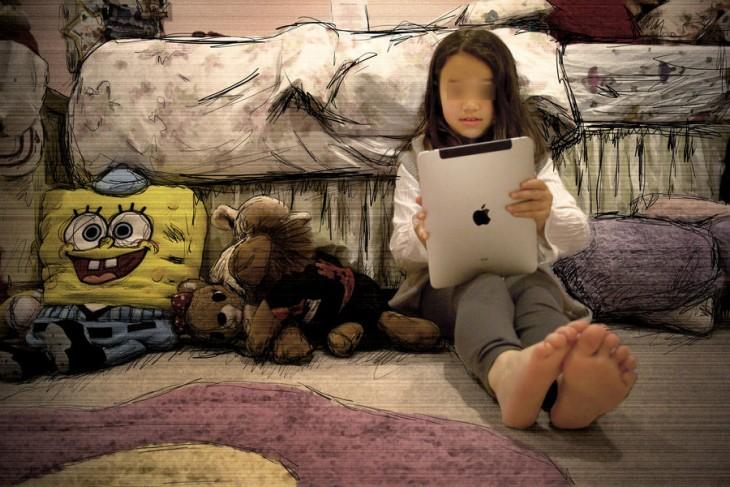 niña jugando en su habitación con el ipad