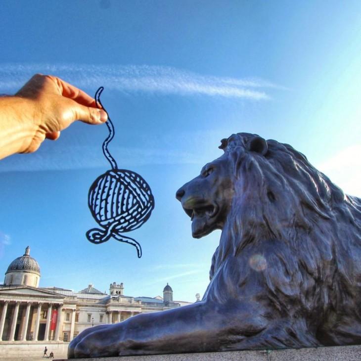 Trafalgar Square, Londres, com um corte de papel na frente dele