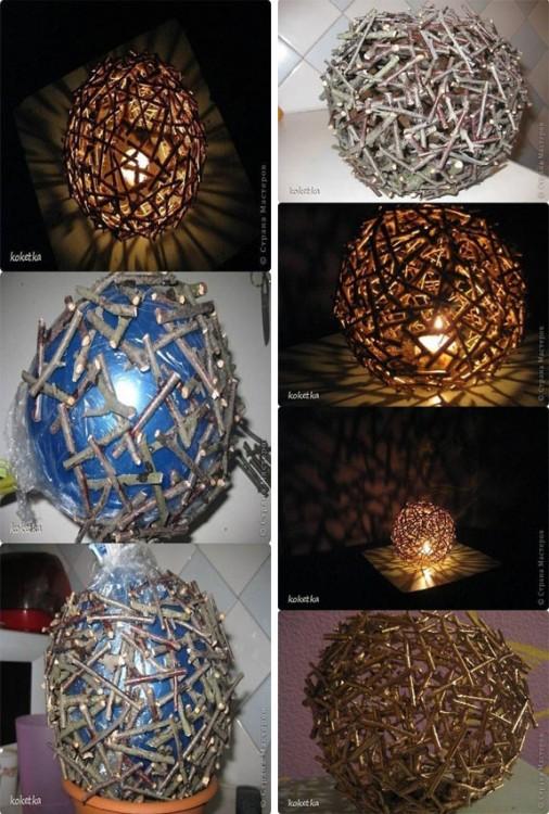 lámpara hecha de ramas con un globo como base