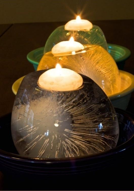 velas sobre globos llenos de agua congelados